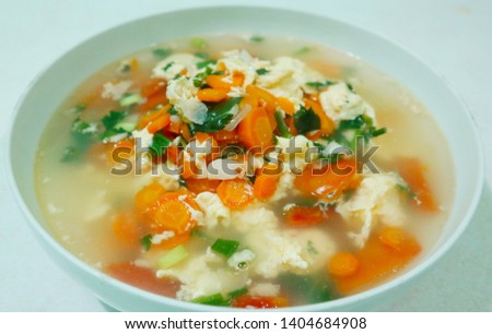 soup is dominated by eggs and tomatoes #1404684908