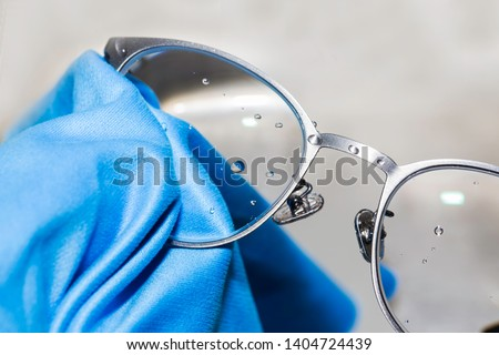 cleaning glasses lens to be clean, clear #1404724439