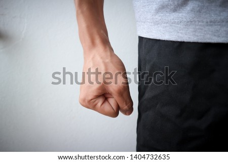 Flea angry man wearing a gray shirt and black pants emotionally angry anger of asian people and blood vessels at hand and white background texture objects #1404732635