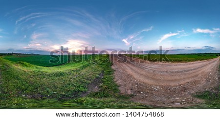 seamless spherical hdri panorama 360 degrees angle view on gravel road among fields in summer evening sunset with awesome clouds in equirectangular projection, ready VR AR virtual reality content
