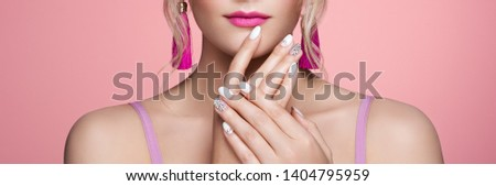 Beauty Woman with perfect Makeup and Manicure. Glamour Girl with Jewelry. Pink Lips and Nails. Beauty girls Face isolated on light Background. Fashion photo #1404795959