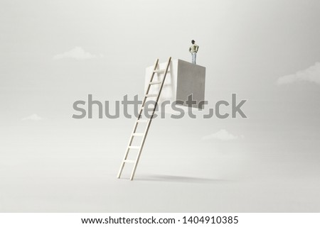 man on the top of a suspended cube observing the future, surreal concept #1404910385