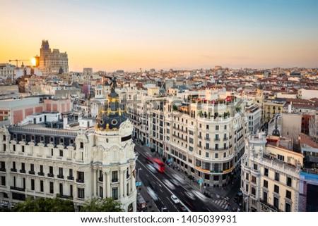 Madrid, Spain, sunset over landmark buildings on Gran Via street.  #1405039931
