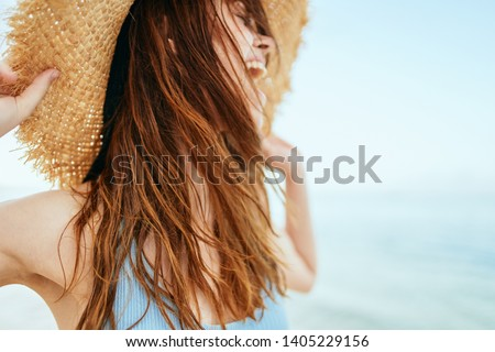 woman with hat laughs at sea ocean nature summer heat                              #1405229156