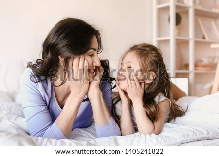 Happy mother with daughter resting at home #1405241822