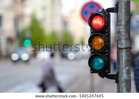 A city crossing with a semaphore. Red light in semaphore. #1405247645
