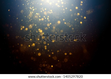 Dark Abstract Gold bokeh sparkle on black background #1405297820
