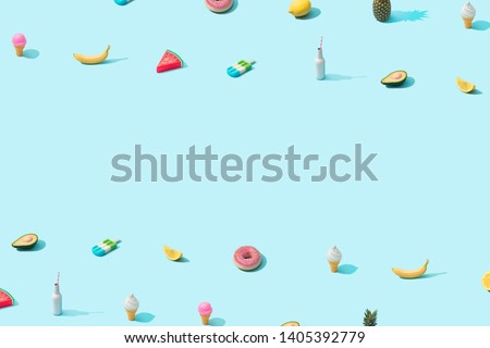 Trendy sunlight Summer pattern made with various summer food on bright light blue background. Minimal summer food concept. #1405392779