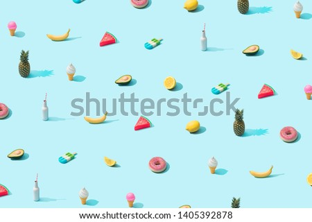 Trendy sunlight Summer pattern made with various summer food on bright light blue background. Minimal summer food concept. #1405392878