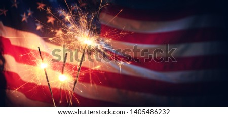 Vintage Celebration With Sparklers And Defocused American Flag - Independence Day  Royalty-Free Stock Photo #1405486232