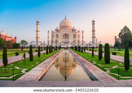 Taj Mahal is a white marble mausoleum on the bank of the Yamuna river in Agra city, Uttar Pradesh state, India Royalty-Free Stock Photo #1405522610