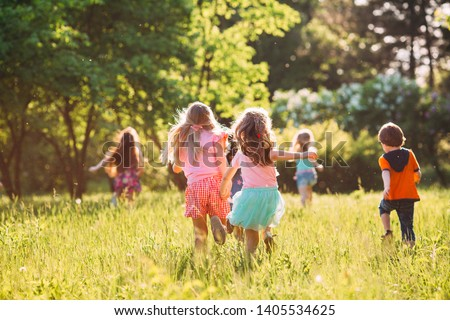 Large group of kids, friends boys and girls running in the park on sunny summer day in casual clothes  #1405534625