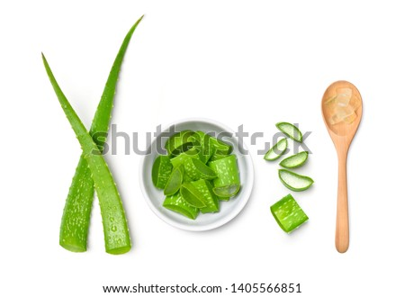 Top view of Fresh Aloe vera leaves and sliced in white bowl with gel in wooden spoon isolated on white background. #1405566851