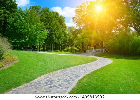 Sunrise beam in beautiful park #1405813502