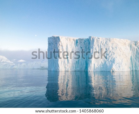 The glaciers are melting on arctic ocean in Greenland. Big glaciers day by day broking and dangerous for world climate system. Shooting day was foggy weather and glaciers didn't look clear.  #1405868060