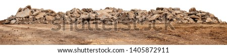 Isolated views of debris from concrete roads that were demolished, destroyed and left on the ground for construction. Royalty-Free Stock Photo #1405872911