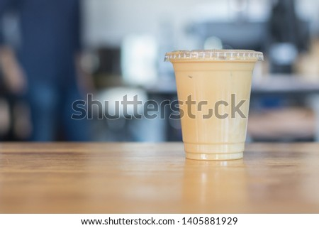 Iced milk coffee in plastic cup with cover.no straw.Indoor cafe #1405881929