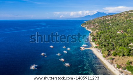 Aerial view bay and shore in Oslob, Cebu, Philippine, best place to snorkel and scuba drive and Whale Shark Watching, There is a deep clean blue ocean and has many local Filipino boats in the sea. #1405911293