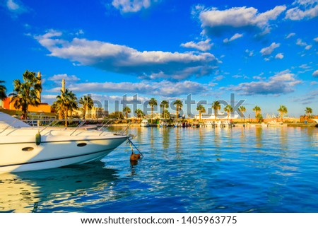 White luxury yachts in sea harbor of Hurghada, Egypt. Marina with tourist boats on Red Sea #1405963775