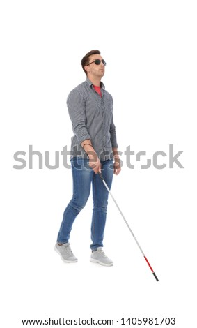 Young blind person with long cane walking on white background #1405981703