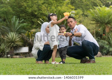 Malay family at recreational park having fun #1406031599