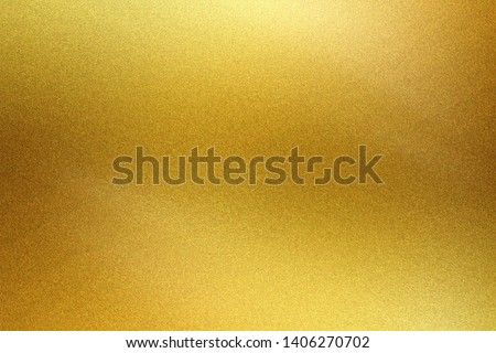 Brushed golden metal foil surface, abstract texture background