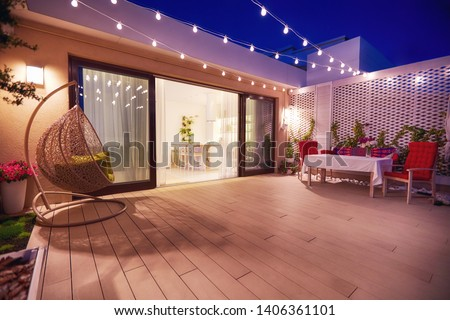 evening patio area with open space kitchen and sliding doors #1406361101