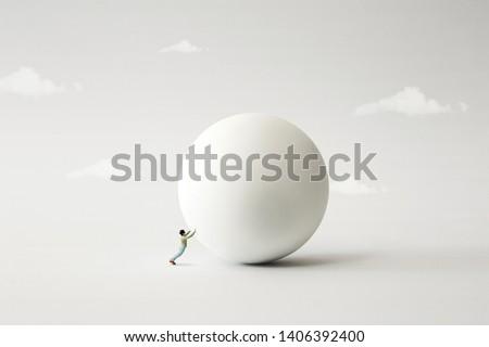 man rolling big heavy ball, surreal concept #1406392400