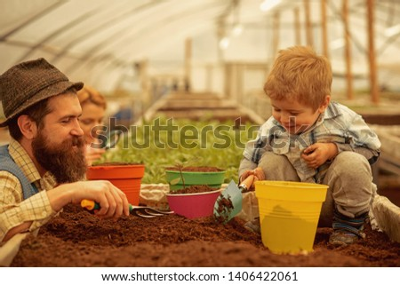 creative people will get success in everything. father and son are creative people. business for creative people. creative people work in greenhouse. creativity #1406422061