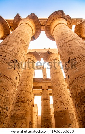 EXPLORING EGYPT - KARNAK TEMPLE - Massive columns inside beautiful Egyptian landmark with hieroglyphics, and ancient symbols. Famous landmark in the world near the Nile River and Luxor, Egypt #1406550638