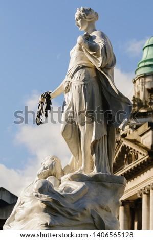 The Titanic Memorial in the  Titanic Memorial Garden at Belfast City Hall, Northern Ireland. Royalty-Free Stock Photo #1406565128