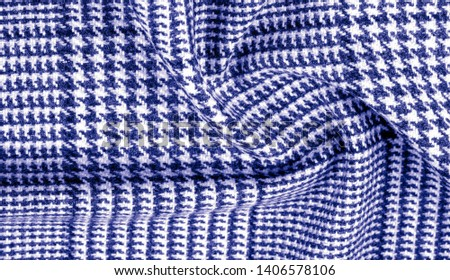 Background texture, pattern. The fabric is thick, warm with a checkered pattern, blue. Stop. You made the right choice by purchasing this photo, your design will be great with this image. #1406578106
