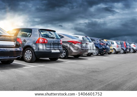 Cars in the parking lot. Parking passenger cars. Royalty-Free Stock Photo #1406601752