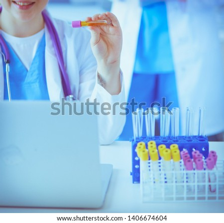 Two young female doctors at medical laboratory with tests. #1406674604
