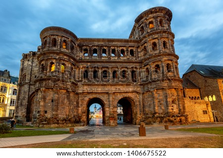 Porta Nigra, an ancient roman gate in Trier, Germany, is the main historical landmark and UNESCO World Culture heritage site Royalty-Free Stock Photo #1406675522