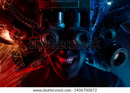 Photo of a cyberpunk male head portrait with robotic helmet with wires, metal parts and binoculars on black background. #1406700872