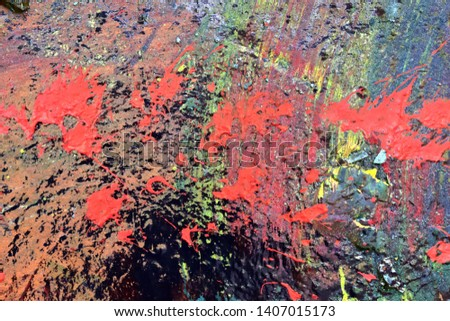 Colorful paint splashes at old and weathered concrete walls #1407015173