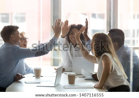 Happy multicultural executive team people give high five, diverse motivated office employees group engaged in teambuilding spirit promise trust integrity celebrate shared business success win concept #1407116555