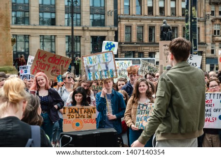 Glasgow, Scotland - 5/24/2019: Protesters at George Square rallying against large companies, pollution and eating meat to raise awareness of climate change.  #1407140354