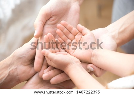 Close up of three caucasian person stack their palms. Grandmother mother and granddaughter holding their hands together. Gesture sign of support and love, unity togetherness relative people concept Royalty-Free Stock Photo #1407222395