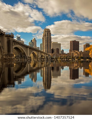 skyline of Minneapolis reflected in Mississippi River