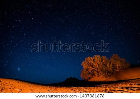 Night sky in moroccan desert Erg Chegaga Royalty-Free Stock Photo #1407361676