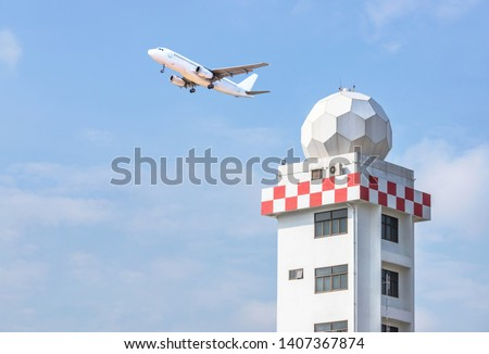 Aeronautical meteorological observations station tower or weather observations radar dome station tower for helps aircraft take off and land safety transportation with passenger airplane taking off  Royalty-Free Stock Photo #1407367874