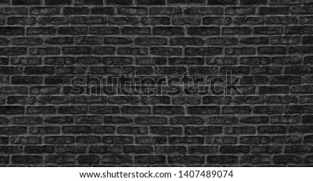 Black brick wall texture. Old rough brickwork. Dark grunge background #1407489074