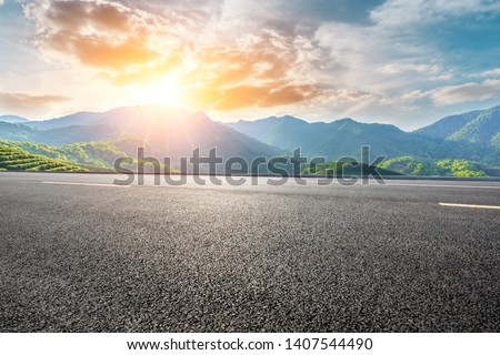 Empty highway road and beautiful mountain with clouds landscape #1407544490