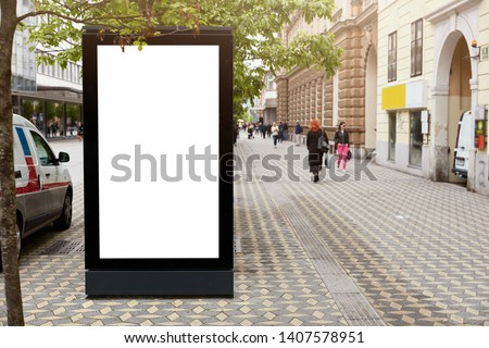 Signboard with mock up space for your commercial information, advertising content against city background, transport and people. Blank street billboard poster or lightbox. Outdoor promotion concept. #1407578951