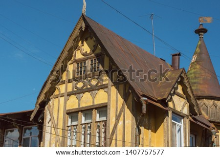 Old German wooden yellow building. #1407757577