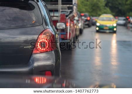 traffic jam with row of cars during raining, rush hour #1407762773