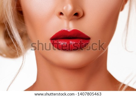 Red Lip gloss. Beautiful natural lips Red color. Sexy Lips. Beautiful Make-up Closeup. Lip Gloss Cherry Color. Texture. Volume and Beauty of the Lips. Plump  lips.       #1407805463