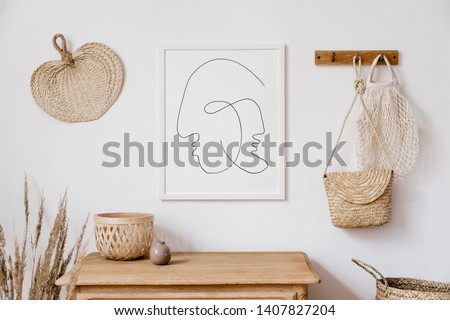 Stylish korean interior of living room with white mock up poster frame, elegant accessories, flowers in vase, wooden shelf and hanging rattan leaf, bags. Minimalistic concept of home decor. Template.  Royalty-Free Stock Photo #1407827204